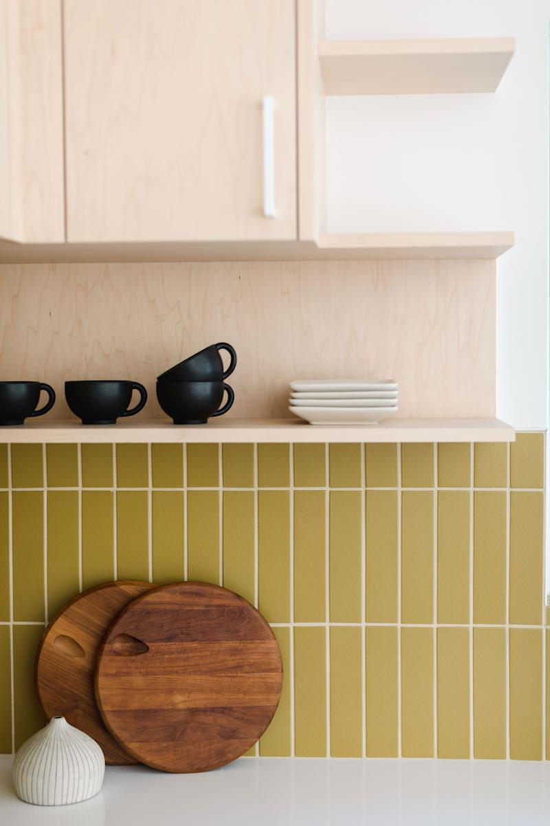 Designer Jonathan Taylor finds that a mix of exposed shelves for select display items and cabinets for additional storage work best for most people.