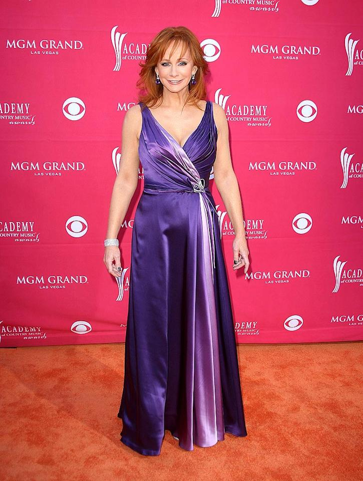 "The legendary Reba McEntire played it safe in a low-cut purple satin frock. Jason Merritt/<a href=""http://www.gettyimages.com/"" target=""new"">GettyImages.com</a> - April 5, 2009"