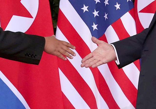 <p>U.S. President Donald Trump shakes hands with North Korean leader Kim Jong Un at the Capella Hotel on Sentosa island in Singapore June 12, 2018. (Photo: Jonathan Ernst/Reuters) </p>