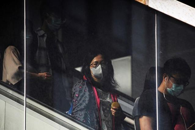 People go to work wearing protective face masks, amid coronavirus disease (COVID-19) concerns, in Taipei
