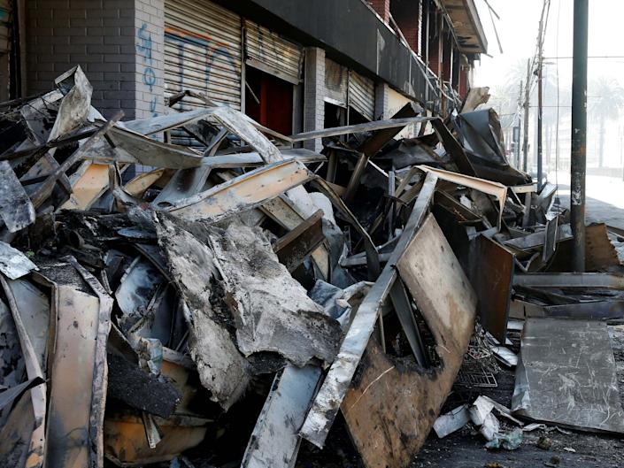 Debris of a burnt and looted supermarket in Chile: REUTERS