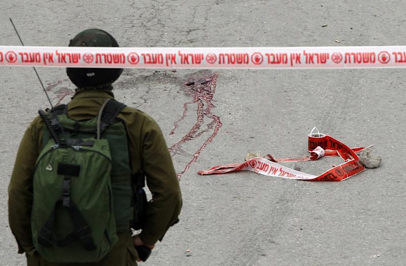 Blood stains from the body of a Palestinian assailant who was allegedly shot in the head by an Israeli soldier, in the West Bank town of Hebron on March 24, 2016