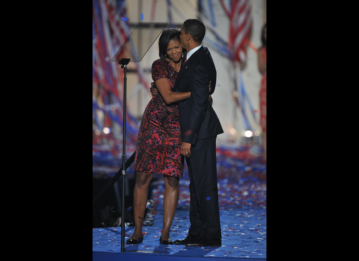 Democratic presidential nominee Barack Obama kisses his wife Michelle on stage at the end of the Democratic National Convention 2008 at the Invesco Field in Denver, Colorado, on August 28, 2008. Obama formally accepted the party's presidential nomination before a capacity crowd of 75,000 delirious supporters, becoming the first-ever black major-party White House pick, exactly 45 years after Martin Luther King's 'I have a dream' anthem to racial harmony. (Photo: PAUL J. RICHARDS/AFP/Getty Images)