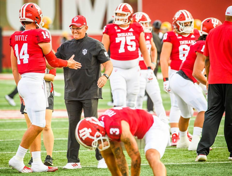 Head coach Tom Allen shakes hands with Jack Tuttle (14) during warm-ups before the start of the Indiana versus Idaho football game at Memorial Stadium on Saturday, September 11, 2021.