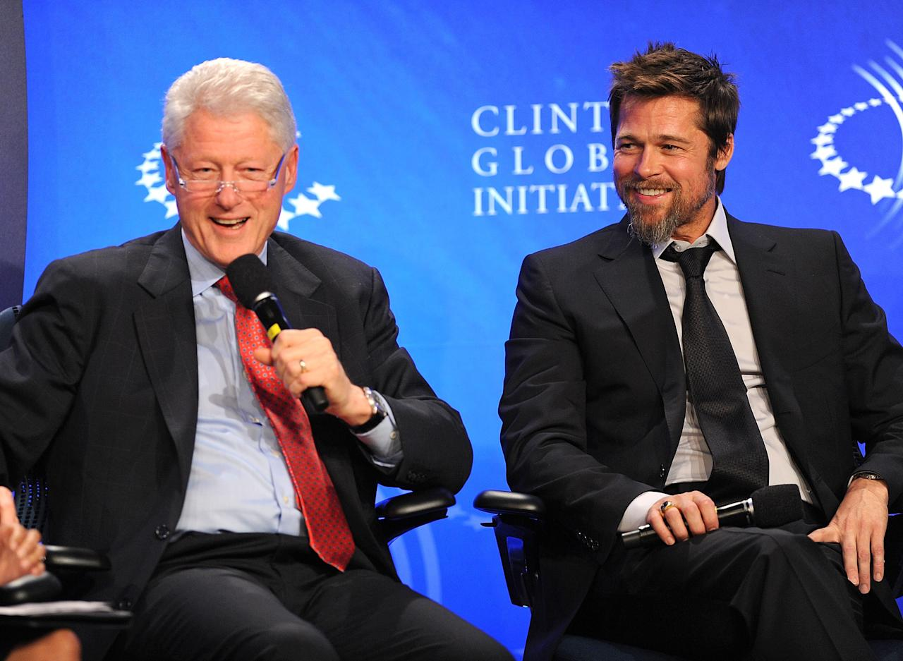 Former President Bill Clinton (L) and actor Brad Pitt host an infrastructure special session during the 2009 Clinton Global Initiative at the Sheraton New York Hotel & Towers on September 24, 2009 in New York City. (Photo by James Devaney/WireImage)