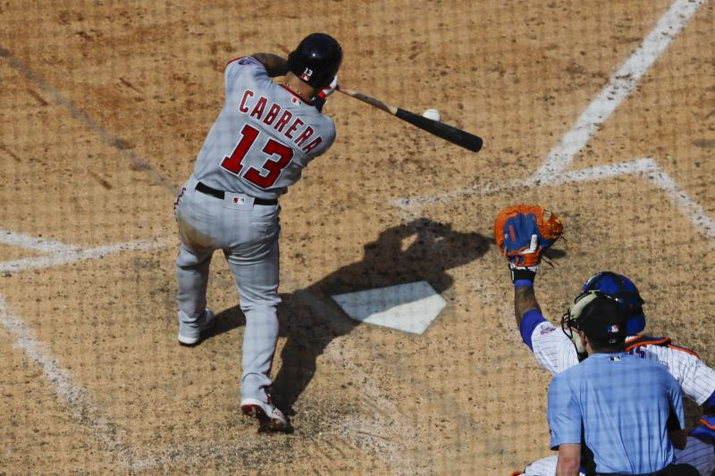 Washington Nationals' Asdrubal Cabrera (13) hits a two-run double during the seventh inning of a baseball game against the New York Mets, Sunday, Aug. 11, 2019, in New York. (AP Photo/Frank Franklin II)