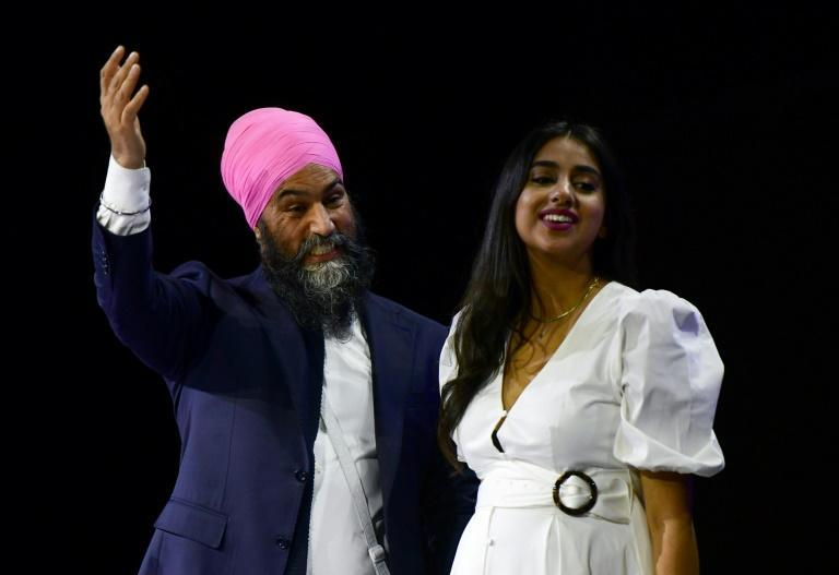 New Democratic Party (NDP) leader Jagmeet Singh, with wife Gurkiran Kaur Sidhu, was heading for 25 seats, according to preliminary results (AFP/Don MacKinnon)