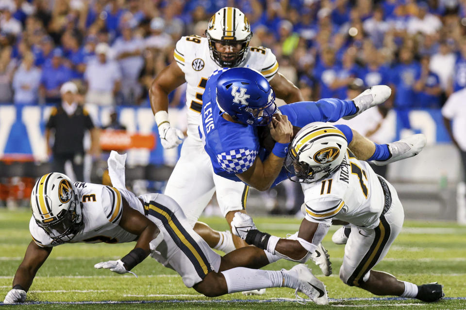 Kentucky quarterback Will Levis (7) is tackled during the second half of the team's NCAA college football game against Missouri in Lexington, Ky., Saturday, Sept. 11, 2021. (AP Photo/Michael Clubb)