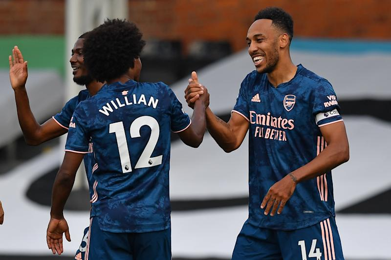 Pierre-Emerick Aubameyang (right) capped Arsenal's 3-0 rout of Fulham in Saturday's Premier League opener. (Ben Stansall/Getty Images)