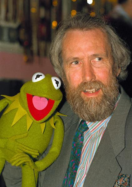 """FILE - In this Feb. 1988 file photo, Jim Henson, creator of the Muppets, poses with Kermit the Frog. Kermit, Miss Piggy, Bert and Ernie of """"Sesame Street"""" fame, the stars of """"Fraggle Rock"""" and other puppets, costumes and items from throughout Henson's career have been donated to the Museum of the Moving Image, which is building a new gallery to house them, the institution announced Tuesday, May 21, 2013. (AP Photo/file)"""