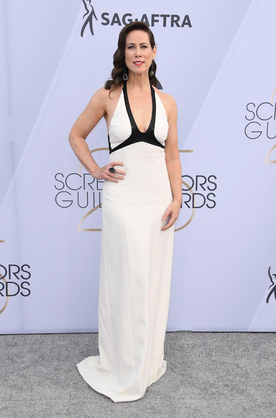 <p>Wearing a black and white Narciso Rodriguez gown, Stuart Weitzman shoes, and Kimberly McDonald jewelry.</p>
