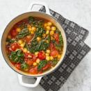 """<p>Forget stews that take hours to make in a crockpot; this one only takes 25 minutes. The chickpeas in it serve as a lighter replacement for potatoes or other carb-heavy foods that often go in stews. </p><p><em><a href=""""https://www.womansday.com/food-recipes/a32675058/chickpea-and-kale-stew-recipe/"""" rel=""""nofollow noopener"""" target=""""_blank"""" data-ylk=""""slk:Get the Quick Chickpea and Kale Stew recipe."""" class=""""link rapid-noclick-resp"""">Get the Quick Chickpea and Kale Stew recipe.</a></em></p>"""