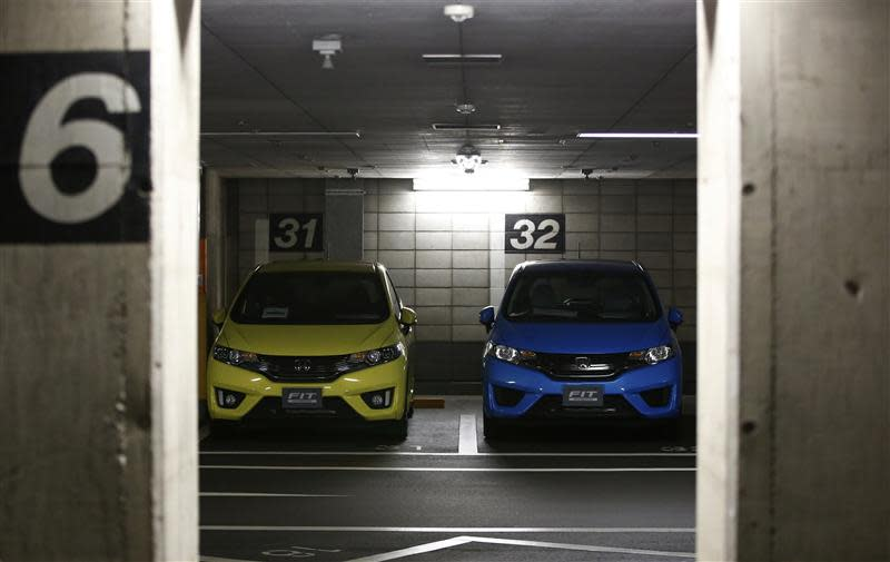 Honda Motor's Fit subcompact hybrid cars are parked in a basement garage in Tokyo