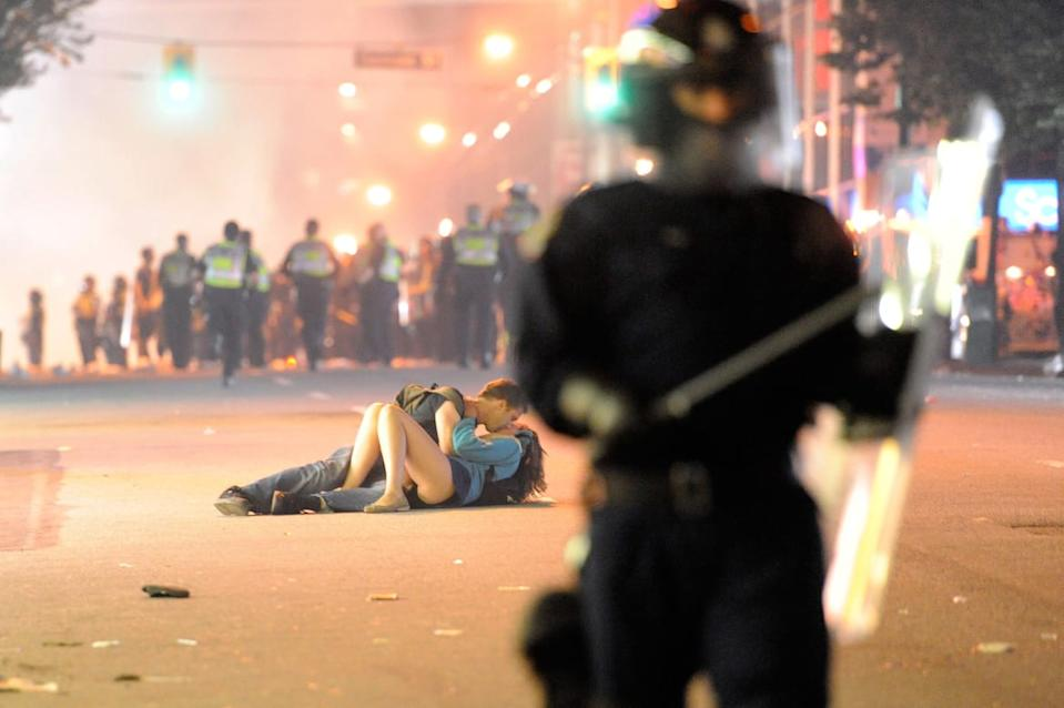 "<div class=""inline-image__caption""><p>Riot police walk in the street as a couple kiss on June 15, 2011 in Vancouver, Canada. Vancouver broke out in riots after their hockey team the Vancouver Canucks lost in Game Seven of the Stanley Cup Finals.</p></div> <div class=""inline-image__credit"">Rich Lam/Getty</div>"