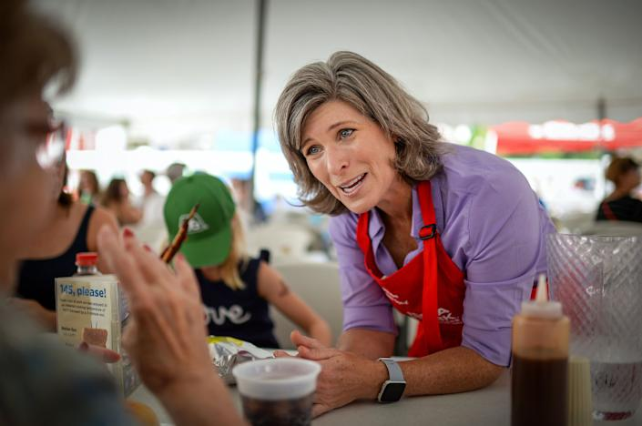 "Sen. Joni Ernst talks to voters at the Iowa State Fair last August. Democrats are trying to capitalize on her suggestion that lawmakers reform Social Security ""behind closed doors."" (Photo: Caroline Brehman/Getty Images)"
