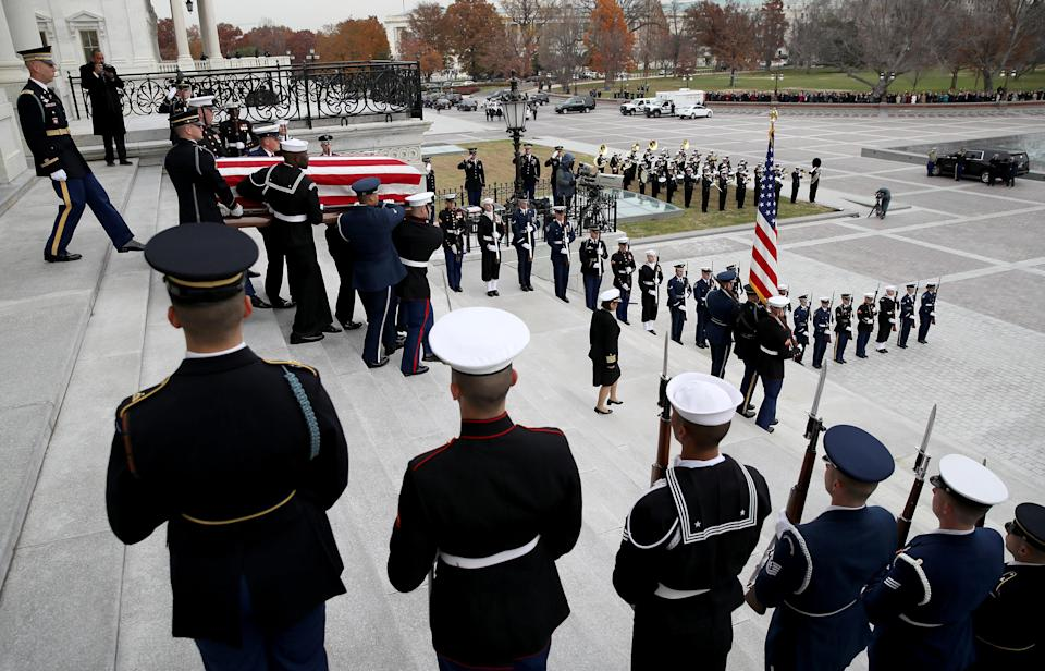 A U.S. military honor guard team carries the flag draped casket of former President George H.W. Bush from the U.S. Capitol, Dec. 5, 2018 in Washington, D.C. (Photo:Win McNamee/Pool via ReutersThe flag-draped casket of former President George H.W. Bush is carried by a joint services military honor guard from the U.S. Capitol, Wednesday, Dec. 5, 2018, in Washington, D.C. (Photo: Alex Brandon/Pool via Reuters)