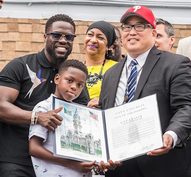 "<p>Hart's hometown of Philadelphia celebrated <a href=""https://www.yahoo.com/celebrity/kevin-hart-honored-kevin-hart-day-philadelphia-214424743.html"" data-ylk=""slk:Kevin Hart Day;outcm:mb_qualified_link;_E:mb_qualified_link"" class=""link rapid-noclick-resp newsroom-embed-article"">Kevin Hart Day</a> on the comedian's 39th birthday. Philadelphia City Councilman David Oh dedicated a mural, while Hart's 9-year-old son, Hendrix, looked incredibly proudly of his pop. (Photo: Gilbert Carrasquillo/Getty Images) </p>"