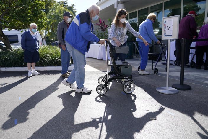 FILE - In this Jan. 19, 2021, file photo, Robert Owens, 90, stands in line with other residents to receive the Pfizer-BioNTech COVID-19 vaccine at John Knox Village in Pompano Beach, Fla. The push to inoculate Americans against the coronavirus is hitting a roadblock: A number of states are reporting they are running out of vaccine, and tens of thousands of people who managed to get appointments for a first dose are seeing them canceled. (AP Photo/Lynne Sladky, File)