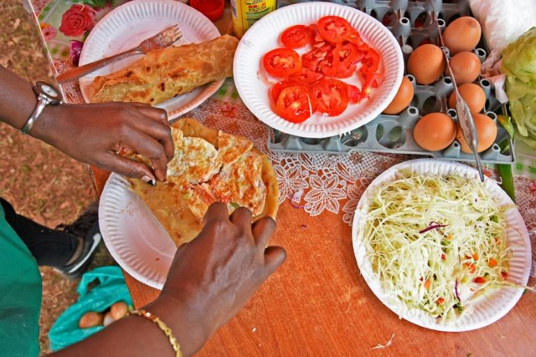 "The ""Rolex"", a sandwich made from an omelette and chapati bread, derives its name from a play on the words ""rolled eggs"""