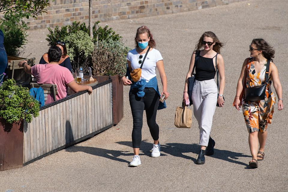 """People enjoying the Autumn sunshine in alongside the Regents Canal in London. The public has been urged to act """"in tune"""" with Covid-19 guidelines before the """"rule of six"""" restrictions come into force on Monday."""
