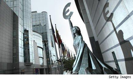 The 'Europe' sculpture of Belgian artist May Claerhout showing a woman holding up the symbol of the Euro stands outside the European Parliament building on November 17, 2011 in Brussels, Belgium.