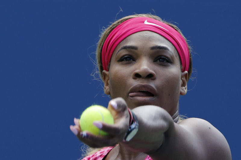 Serena Williams serves to Vania King during their 2014 US Open women's singles match on August 28, 2014 in New York (AFP Photo/Kena Betancur)