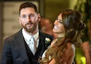 """Argentine media called it the """"wedding of the century"""" for Rosario, the gritty northern port city where Messi, 30, and his bride, 29, met when the player was nine years old (AFP Photo/EITAN ABRAMOVICH)"""