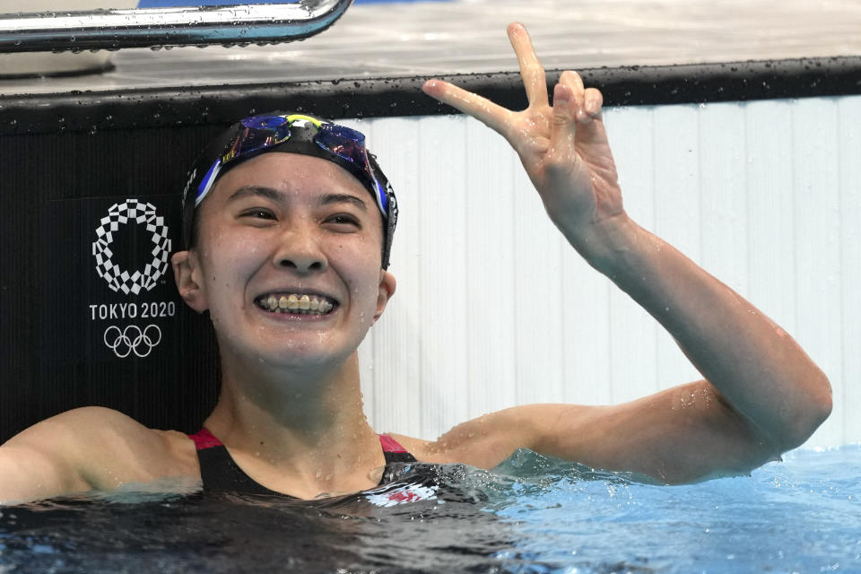 Yui Ohashi of Japan waves after winning the women's 200-meter individual medley final at the 2020 Summer Olympics, Wednesday, July 28, 2021, in Tokyo, Japan. (AP Photo/Matthias Schrader)