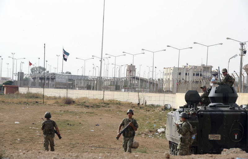 Turkish military station at the border with Syria, across from Syrian rebel-controlled Tel Abyad town, right, in Akcakale, Turkey, Sunday, Oct. 7, 2012. (AP Photo)