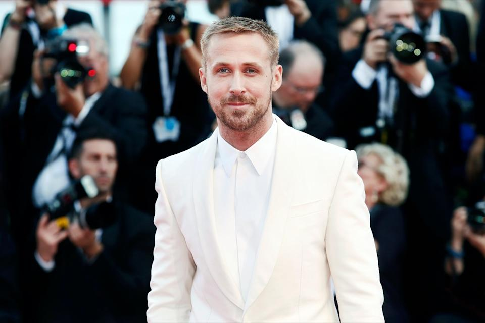 "Ryan Gosling wears a white suit to the premiere of ""First Man"" in 2018"