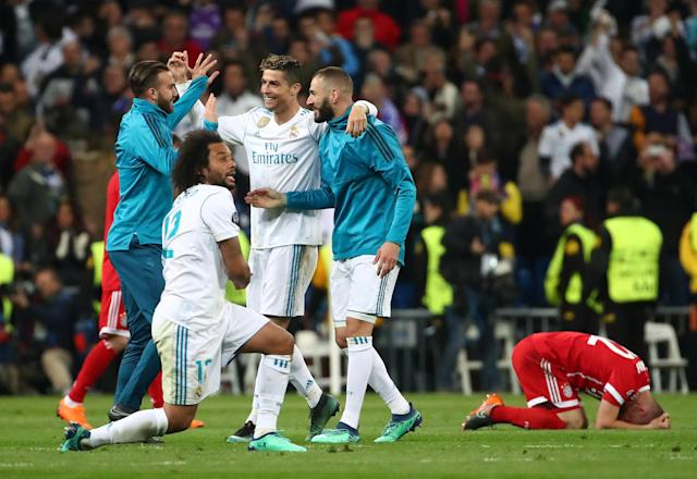 Soccer Football - Champions League Semi Final Second Leg - Real Madrid v Bayern Munich - Santiago Bernabeu, Madrid, Spain - May 1, 2018 Real Madrid's Marcelo celebrates with team mates after the match REUTERS/Michael Dalder