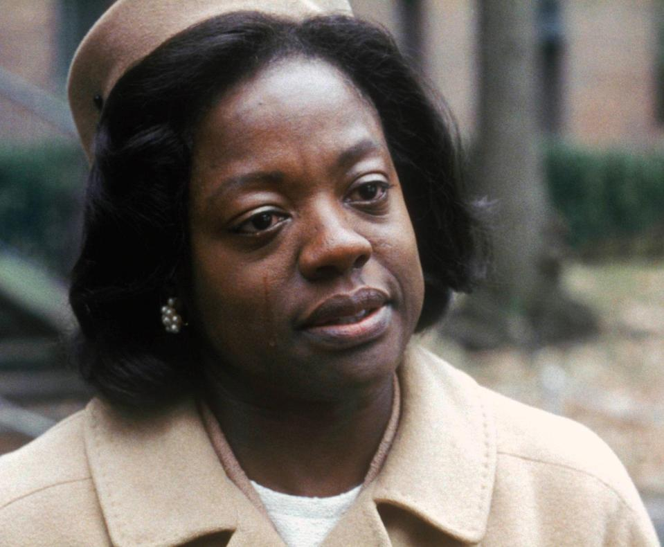 """Davis's turn in 2008's <em>Doubt</em> further cemented just how much the actor could do with so little. With just about eight minutes of screen time, Davis earned her first Oscar nomination for her role as Mrs. Miller, a desperate working mother fiercely protective of her son who's potentially been preyed upon by a priest at his Catholic school. <a href=""""https://www.youtube.com/watch?v=ThsZ8wfhJpk"""" rel=""""nofollow noopener"""" target=""""_blank"""" data-ylk=""""slk:In her only scene"""" class=""""link rapid-noclick-resp"""">In her only scene</a>, Davis goes toe-to-toe with the legendary <strong>Meryl Streep</strong> and ultimately steals focus, flooding the screen with love for her lonely boy via her soon-to-be signature runny-nosed cry. Davis vs. Streep is a screen-acting master class that would finally get Hollywood to pay attention to Davis's incredible potential."""
