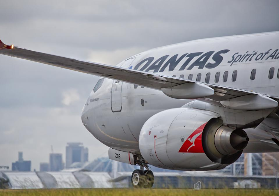 Sydney,Australia - February 20, 2016: A QANTAS Boeing 737 taxies towards the terminal after landing at the city's airport. QANTAS is the flag carrier for Australia.