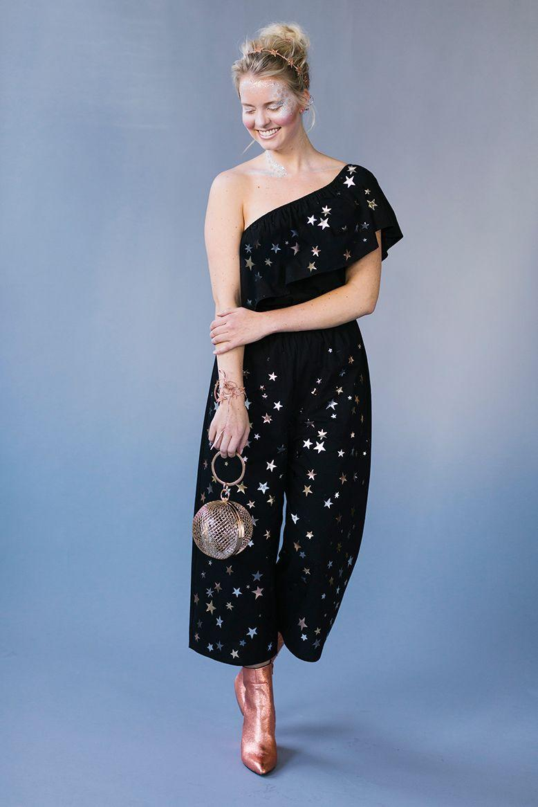 """<p>Ideal for the Zodiac obsessed, simply add temporary star stickers to your favorite black jumpsuit to transform into the ultimate gold-dusted Goddess (as if you weren't already).</p><p><a class=""""link rapid-noclick-resp"""" href=""""https://www.amazon.com/eBoot-Stickers-Count-Self-Adhesive-Silver/dp/B07BVPV7JR/ref=sr_1_2?tag=syn-yahoo-20&ascsubtag=%5Bartid%7C10055.g.2750%5Bsrc%7Cyahoo-us"""" rel=""""nofollow noopener"""" target=""""_blank"""" data-ylk=""""slk:SHOP STAR STICKERS"""">SHOP STAR STICKERS</a></p><p><em><a href=""""https://thehousethatlarsbuilt.com/2017/10/4-easy-iron-costumes.html/"""" rel=""""nofollow noopener"""" target=""""_blank"""" data-ylk=""""slk:Get the tutorial at The House That Lars Built »"""" class=""""link rapid-noclick-resp"""">Get the tutorial at The House That Lars Built »</a></em> </p>"""