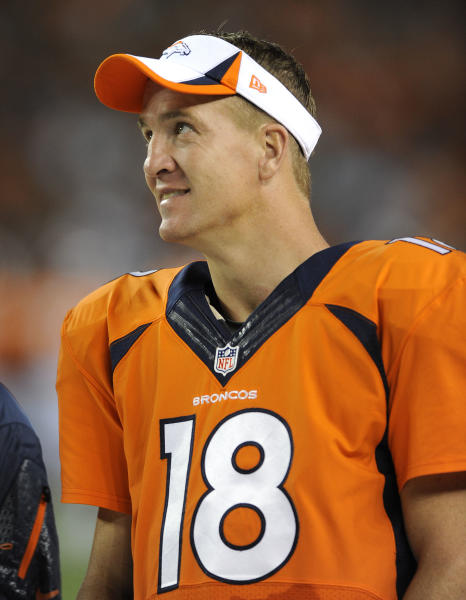 Denver Broncos quarterback Peyton Manning (18) watches from the sidelines against the St. Louis Rams in the fourth quarter of a preseason NFL football game, Saturday, Aug. 24, 2013, in Denver. (AP Photo/Jack Dempsey)