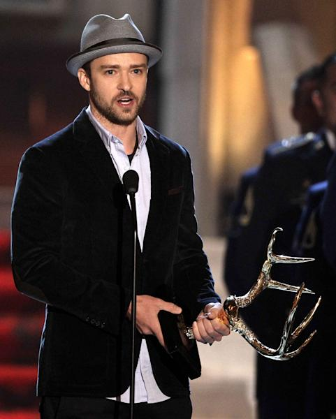"FILE - This June 2, 2012 file photo shows actor-singer Justin Timberlake accepting the troops' choice for entertainer of the year award at the 2012 Guys Choice Awards in Culver City, Calif. Timberlake is apologizing for a video that shows homeless people offering congratulatory wishes to the pop star and his new bride, Jessica Biel. Timberlake posted an open letter on his website Friday, Oct. 26, saying he didn't know about the video or contribute to it in any way. He calls the video ""distasteful"" and says he's deeply sorry to anyone offended by it but acknowledges it was made by well-meaning friends. The 19-second video titled ""Greetings from your Hollywood friends who just couldn't make it"" shows three people who obviously don't know the famous couple greeting them with wedding wishes. (Photo by Matt Sayles/Invision/AP, file)"