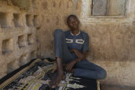 Usama Aminu, 17 year-old, a kidnapped student of the Government Science Secondary School who escaped from bandits is seen during an interview with The Associated Press in Kankara, Nigeria, Wednesday, Dec. 16, 2020. The school boy who escaped says the students were kidnapped by young, armed men in military uniform. Rebels from the Boko Haram extremist group claimed responsibility Tuesday for abducting hundreds of boys from a school in Nigeria's northern Katsina State last week in one of the largest such attacks in years, raising fears of a growing wave of violence in the region. (AP Photo/Sunday Alamba)