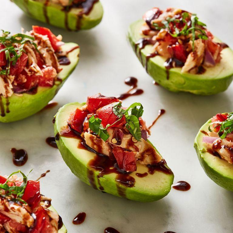 """<p><a href=""""https://www.delish.com/uk/food-news/a32968326/how-to-ripen-avocados/"""" rel=""""nofollow noopener"""" target=""""_blank"""" data-ylk=""""slk:Avocados"""" class=""""link rapid-noclick-resp"""">Avocados</a> make the perfect snack bowls. Therefore, stuffing them full of <a href=""""https://www.delish.com/uk/cooking/recipes/a34529700/bruschetta-chicken-recipe/"""" rel=""""nofollow noopener"""" target=""""_blank"""" data-ylk=""""slk:bruschetta chicken"""" class=""""link rapid-noclick-resp"""">bruschetta chicken</a> was one of easiest decisions we've ever made. You don't need to take off the skin completely — we just think it's super pretty that way. Plus, it make it's easier to to attack with a fork and knife. </p><p>Get the <a href=""""https://www.delish.com/uk/cooking/recipes/a35041036/bruschetta-chicken-stuffed-avocados-recipe/"""" rel=""""nofollow noopener"""" target=""""_blank"""" data-ylk=""""slk:Bruschetta Chicken Stuffed Avocados"""" class=""""link rapid-noclick-resp"""">Bruschetta Chicken Stuffed Avocados</a> recipe.</p>"""