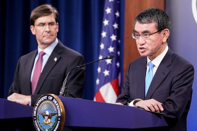U.S. Secretary of Defense Mark Esper looks on as Japan's Defense Minister Taro Kono speaksduring a joint news conference at the Pentagon in Washington