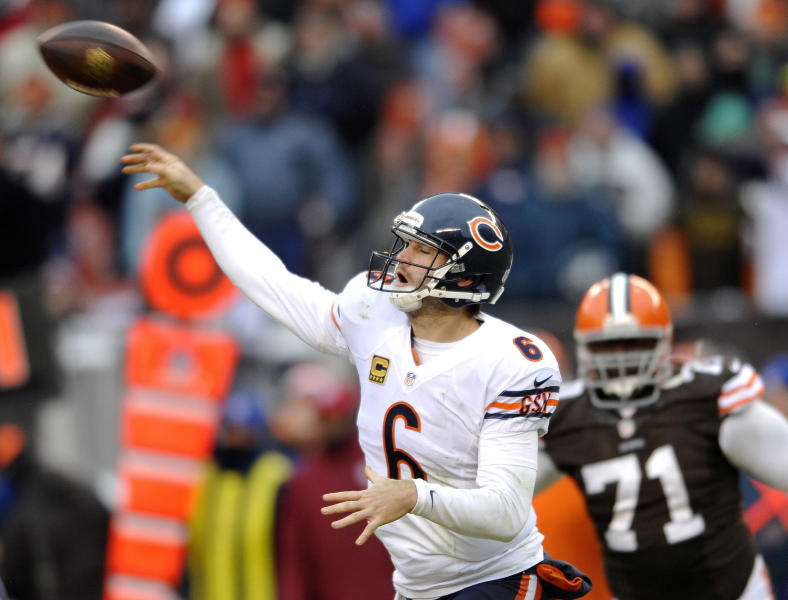 Chicago Bears quarterback Jay Cutler passes during the fourth quarter under pressure from Cleveland Browns defensive end Ahtyba Rubin during an NFL football game Sunday, Dec. 15, 2013, in Cleveland. Chicago won 38-31. (AP Photo/David Richard)