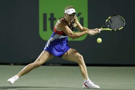Mar 23, 2018; Key Biscayne, FL, USA; Caroline Wozniacki of Denmark hits a backhand against Monica Puig of Puerto Rico (not pictured) on day four of the Miami Open at Tennis Center at Crandon Park. Mandatory Credit: Geoff Burke-USA TODAY Sports