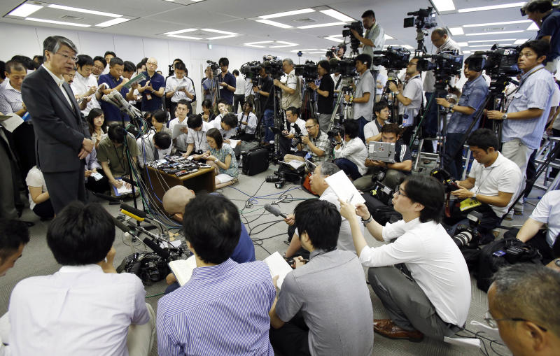 Hokkaido Electric Power Co. Inc. Vice President Osamu Sakai, left, speaks to journalists after filing applications for safety inspections by the Nuclear Regulation Authority (NRA), in Tokyo, Monday, July 8, 2013. Four of nine Japanese nuclear plant operators - supplying the regions of Hokkaido, Kansai, Shikoku and Kyushu - filed the applications by the NRA for 10 reactors at five plants Monday, when new safety requirements take effect. Japan moved a step closer to restarting nuclear reactors Monday as four utility companies applied for inspections at 10 of their idled reactors, the clearest sign of a return to nuclear energy nearly two and a half years after the Fukushima disaster. (AP Photo/Koji Sasahara)
