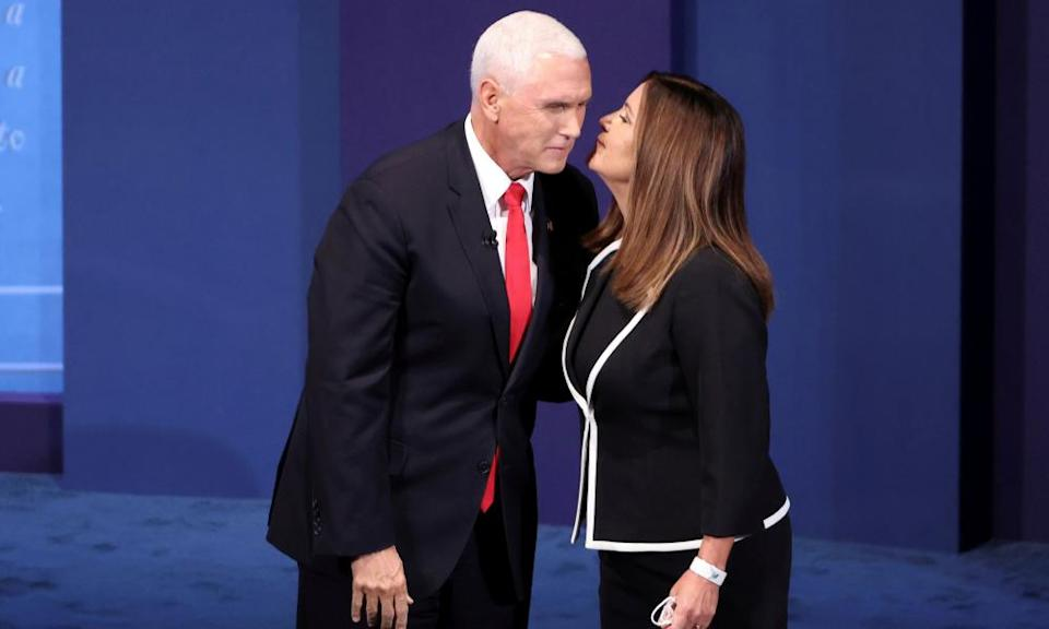 Mike Pence receives a kiss from a maskless Karen Pence, AKA 'Mother'.