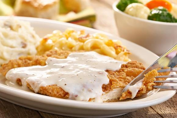 A plate of chicken fried steak and gravy with mashed potatoes from Cracker Barrel.