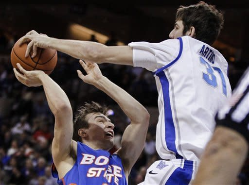 Boise State's Anthony Drmic, left, has his shot blocked by Creighton's Will Artino during the first half of an NCAA college basketball game in Omaha, Neb., Wednesday, Nov. 28, 2012. (AP Photo/Nati Harnik)
