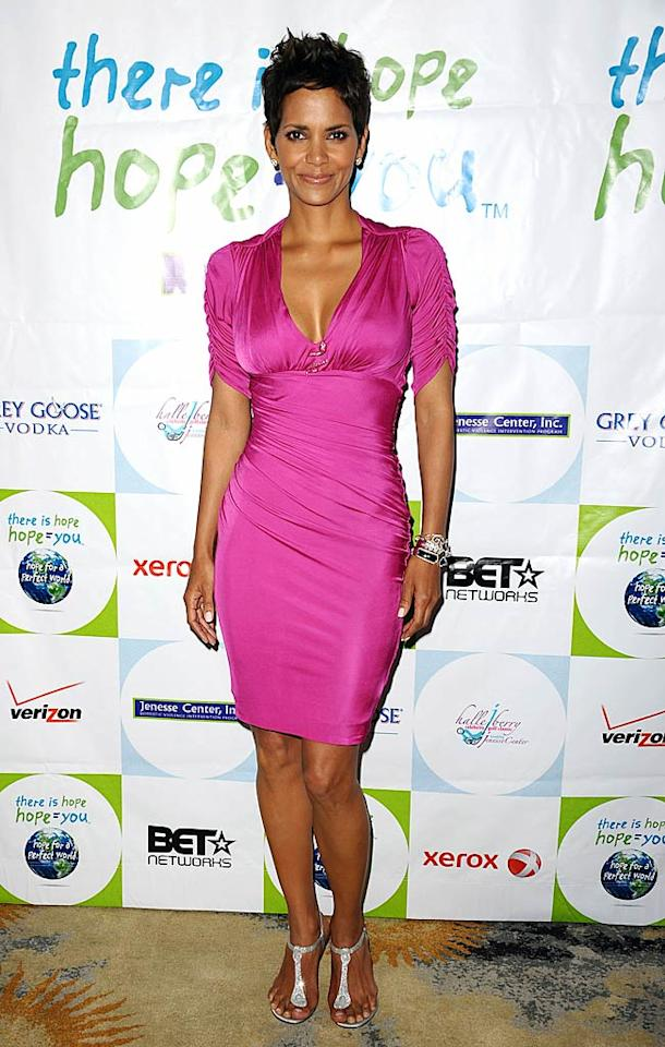 """Halle Berry proved that she's ready for spring by attending this year's Silver Rose soiree in a hot pink Roberto Cavalli creation. The bright color perfectly complemented her skin tone, as did her sparkly Christian Louboutin sandals and Stephen Webster bracelets. Jason LaVeris/<a href=""""http://www.filmmagic.com/"""" target=""""new"""">FilmMagic.com</a> - April 17, 2011"""