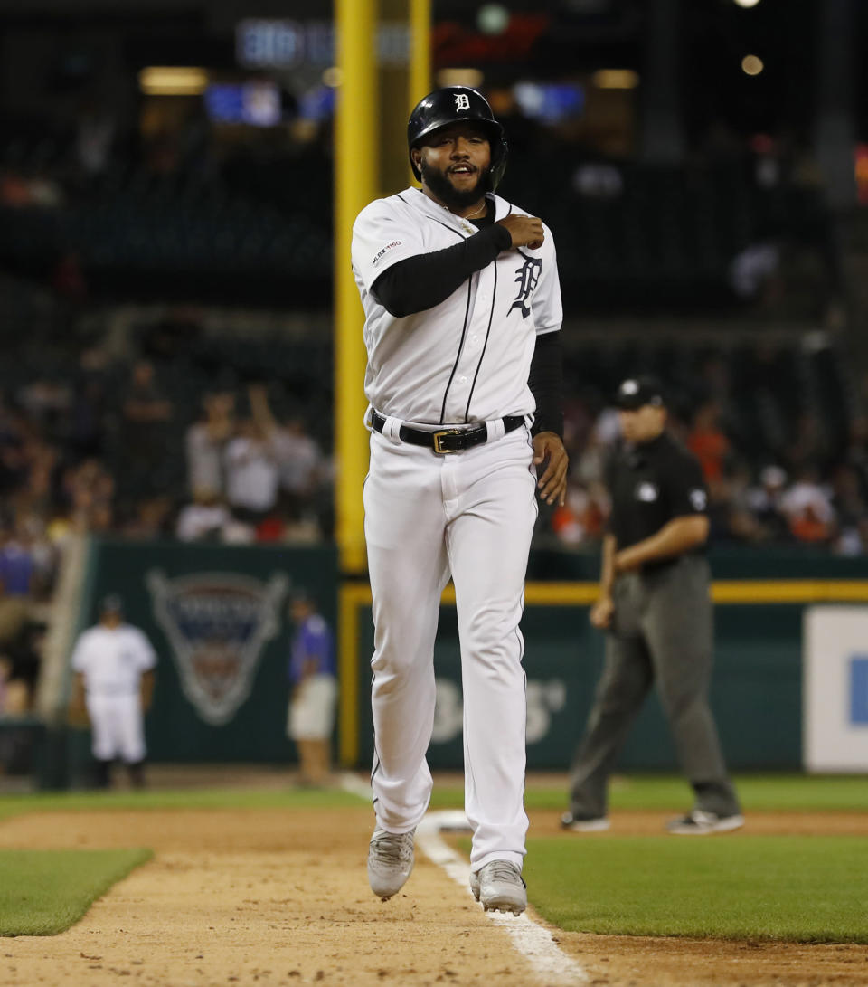Detroit Tigers designated hitter Ronny Rodriguez runs to home plate from third after his triple was reviewed as a two-run home run during the sixth inning of a baseball game against the Minnesota Twins, Saturday, Aug. 31, 2019, in Detroit. (AP Photo/Carlos Osorio)