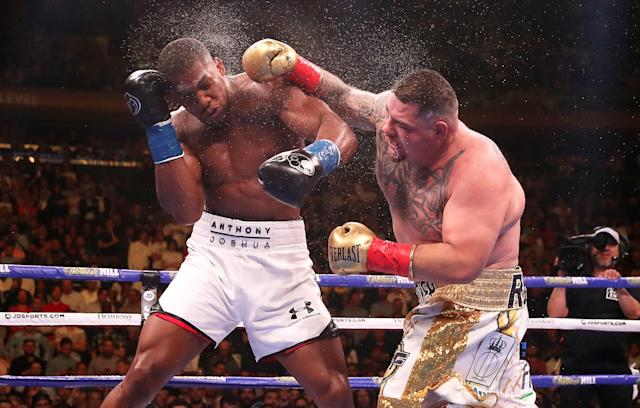 Andy Ruiz Jr (right) lands a punch on Anthony Joshua in the WBA, IBF, WBO and IBO Heavyweight World Championships title fight at Madison Square Garden, New York. (Photo by Nick Potts/PA Images via Getty Images)