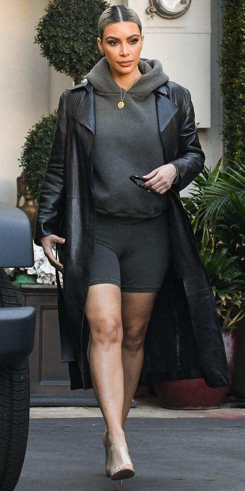 <p>Kim Kardashian stayed loyal to the Yeezybrand rocking biker shorts, a matching hoody, and her favorite clear heels ($650; <a data-ecommerce=