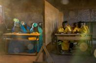 In Agadez, Niger, an Izala school educates about 1,300 students. Izala is a back-to-basics Islamic reformist movement that adheres to conservative practices, such as women covering their faces, but also prizes education. (National Geographic/Pascal Maitre)